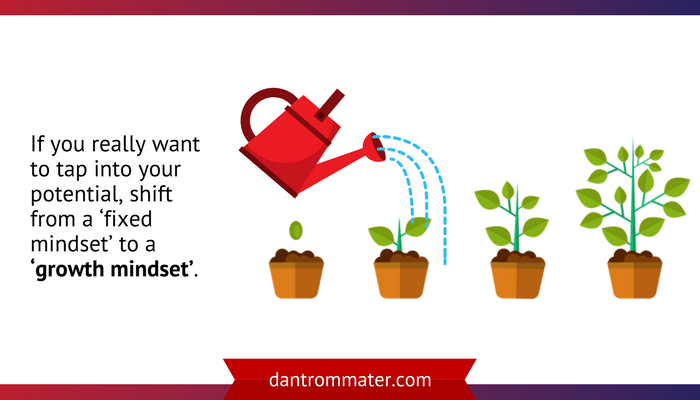 watering can and set of growing plants getting progressively larger