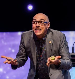 Conference Keynote Speaker Dan Trommater does a magic trick to illustrate change